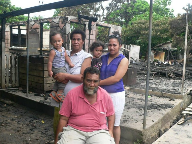 Feleti Finau Hopoate aka ʻUlupano and his family infront in one of their houses destroyed by fire